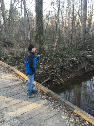 special needs child walk creek bridge