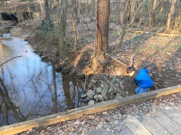 special needs child walk creek bridge