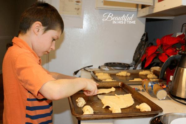 boy making pillsbury crescent rolls