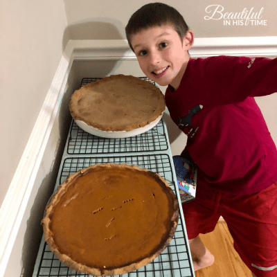 boy makes two pies for Thanksgiving dinner