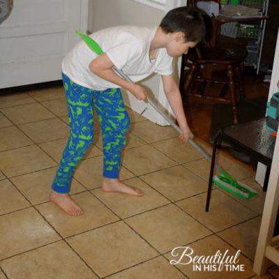 boy using swiffer
