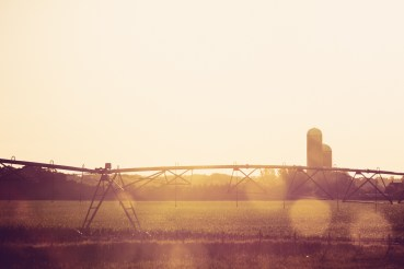 The sun is coming up over an American farm in North Dakota.