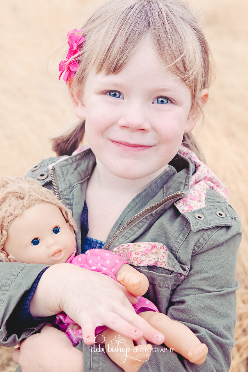 Little girl holding her doll