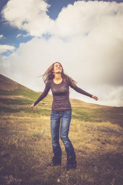 Joyful girl dancing on a Montana prairie