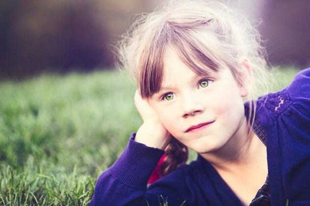 Beautiful young girl daydreaming