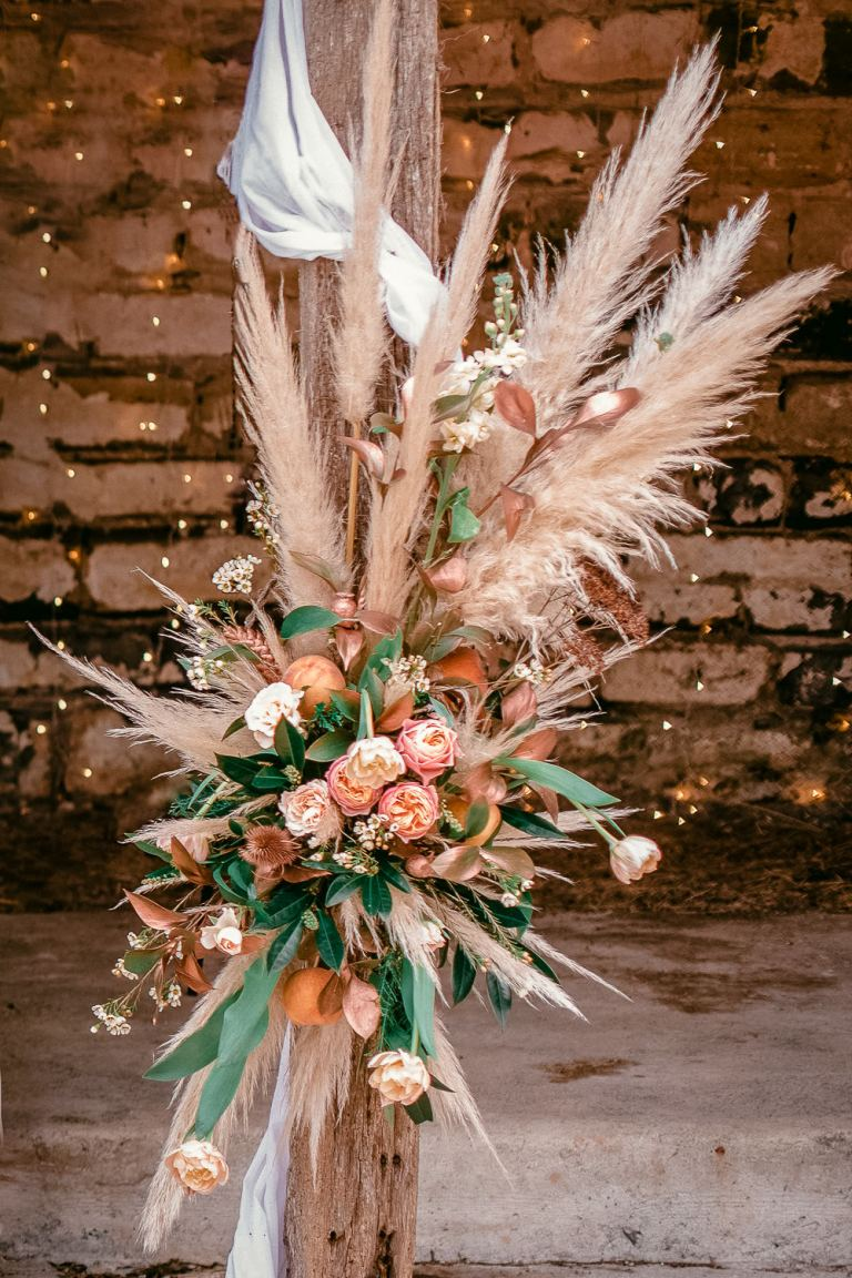 floral arrangement inluding pampas grasses