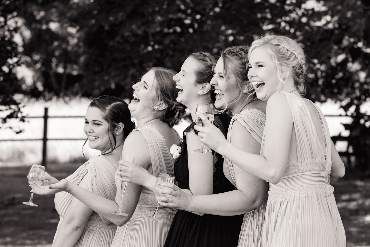 Bridesmaids laughing in the grounds of Silchester House