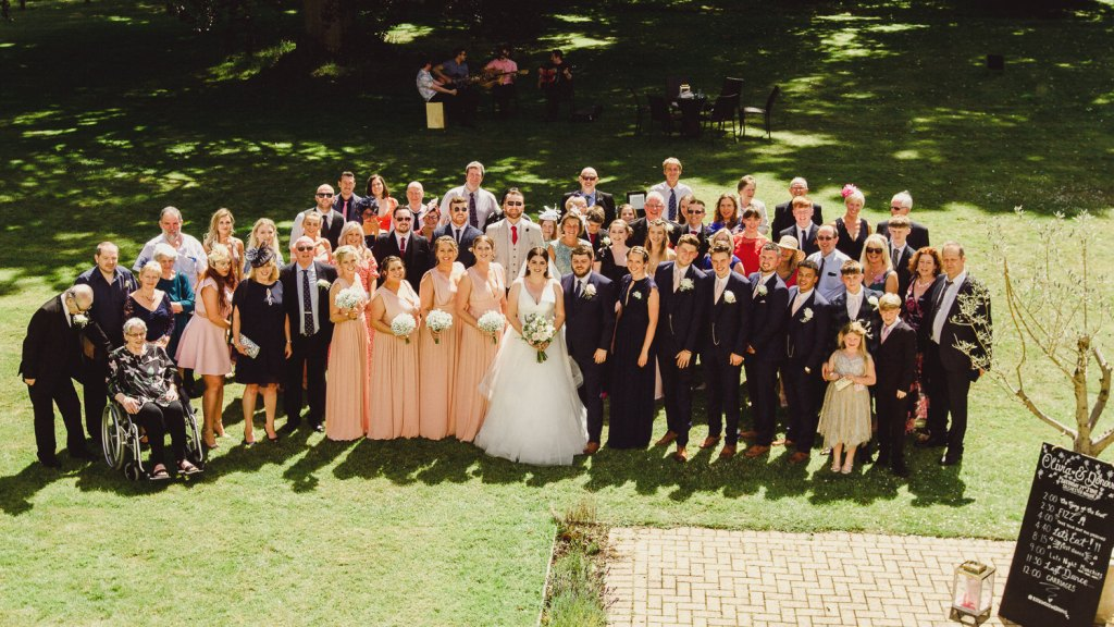 large group shot of wedding group. Donny & Olivia at Silchester House