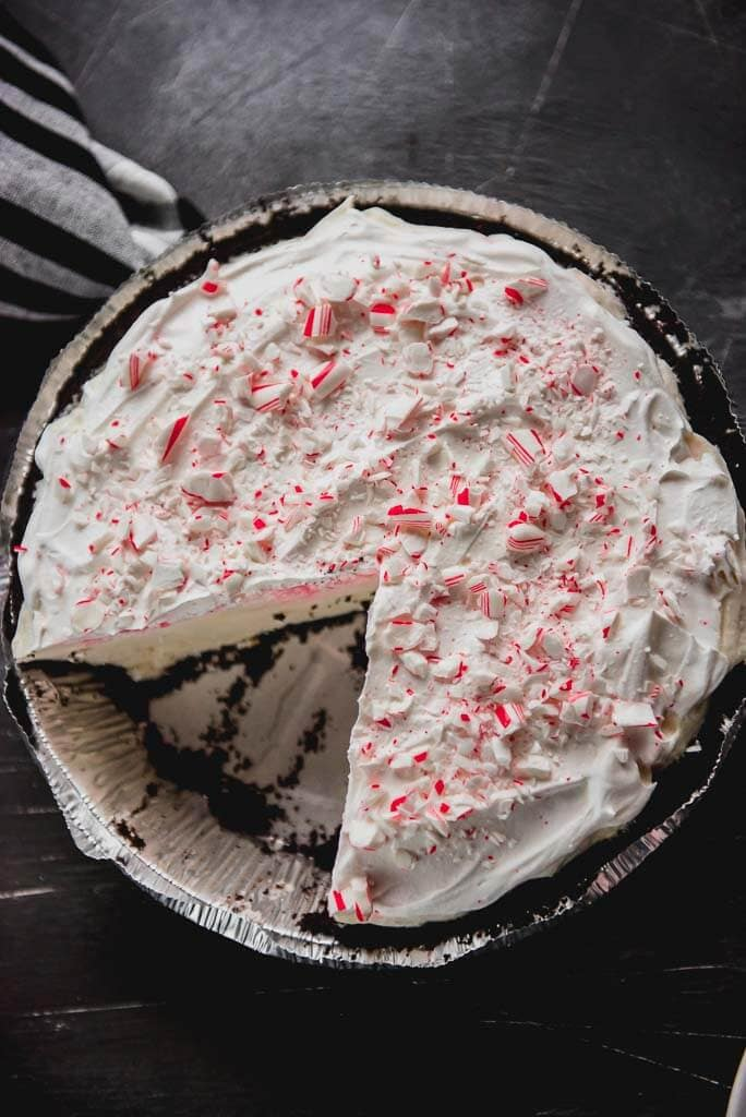 Overhead photo of a White Chocolate Peppermint Oreo Pie with one slice missing