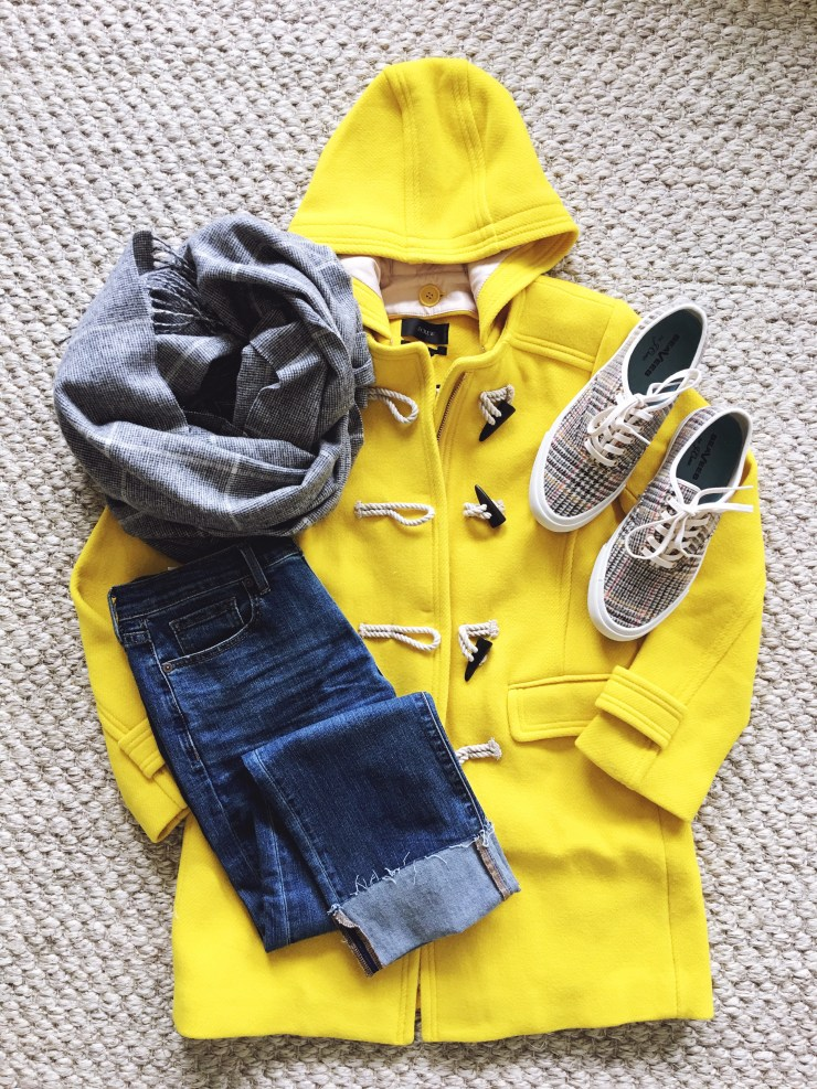 Beautifully Seaside fall outfit flatlay, J.Crew yellow toggle coat, girlfriend jeans, check cape scarf, J.Crew vintage plaid SeaVees
