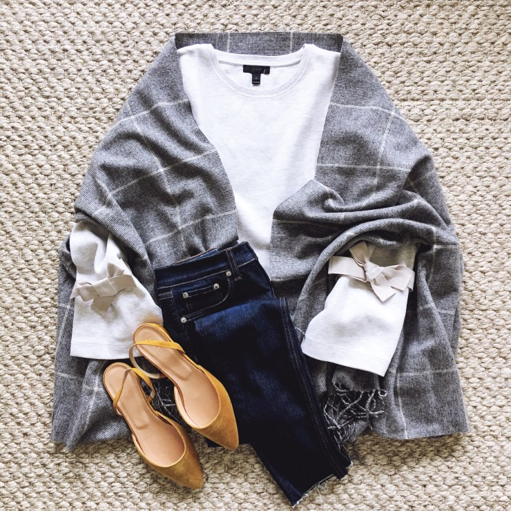 Beautifully Seaside fall style outfit flatlay check scarf cape, high waisted jeans, velvet flats