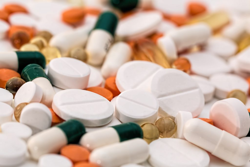 Canva Bunch of White Oval Medication Tablets and White Medication Capsules