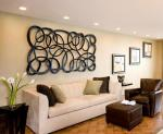 contemporary-hanging-sculputre-for-living-room-living-room-cool-living-room-wall-decor-idea-with-white-brown-black-frames-brown-painting-and-white-wall-attractive-living-room-wall