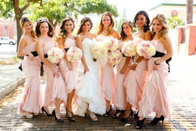 White and Pink Wedding Bouquet and Pink and Black Bridesmaid Dresses
