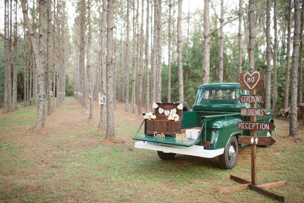 Rustic Outdoor Wedding Directional Sign with Vintage Trunk for Wedding Gifts on Green Vintage Pick Up Truck   Tampa Wedding Floral Designer Northside Florist