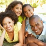 Portrait of Happy Family Piled Up In Park