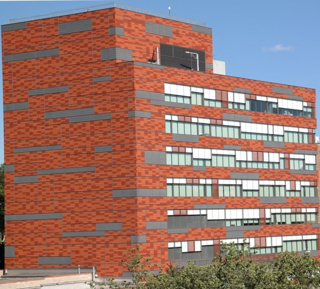 A tall red brick building  Description automatically generated