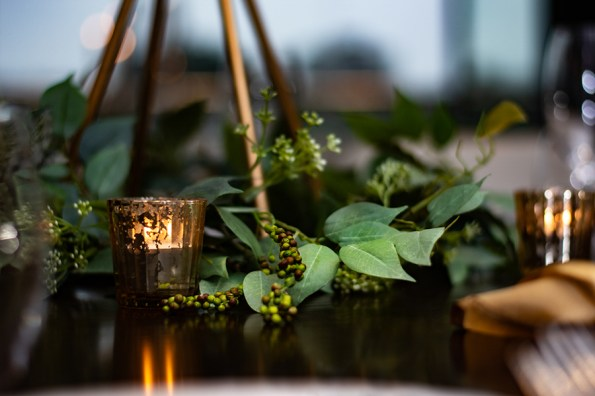 blackbird-wedding-reception-styling-gold-stand-faux-silk-greenery-gold-tealights-table-centrepiece