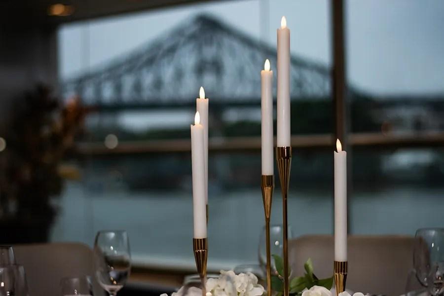 blackbird-wedding-reception-styling-gold-candelabra-candlestick-holder-guest-table-centrepiece-brisbane-storey-bridge-view