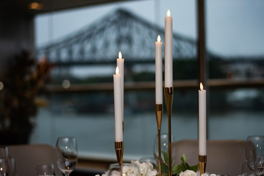 blackbird-wedding-reception-styling-gold-candelabra-candlestick-holder-guest-table-centrepiece-brisbane-storey-bridge-view