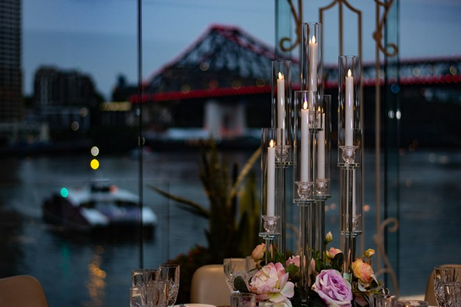 blackbird-wedding-reception-styling-glass-candelabra-candlestick-holder-guest-table-centrepiece-faux-silk-flower-florals-brisbane-storey-bridge-view