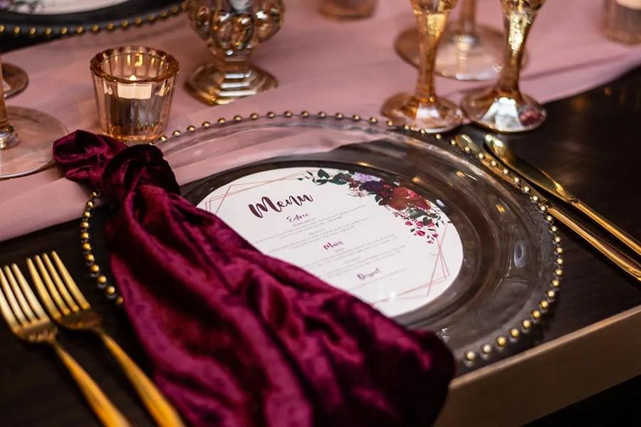 blackbird-wedding-reception-styling-amber-crystal-stemware-burbundy-velvet-napkins-gold-beaded-glass-charger-plates-blush-chiffon-table-runner