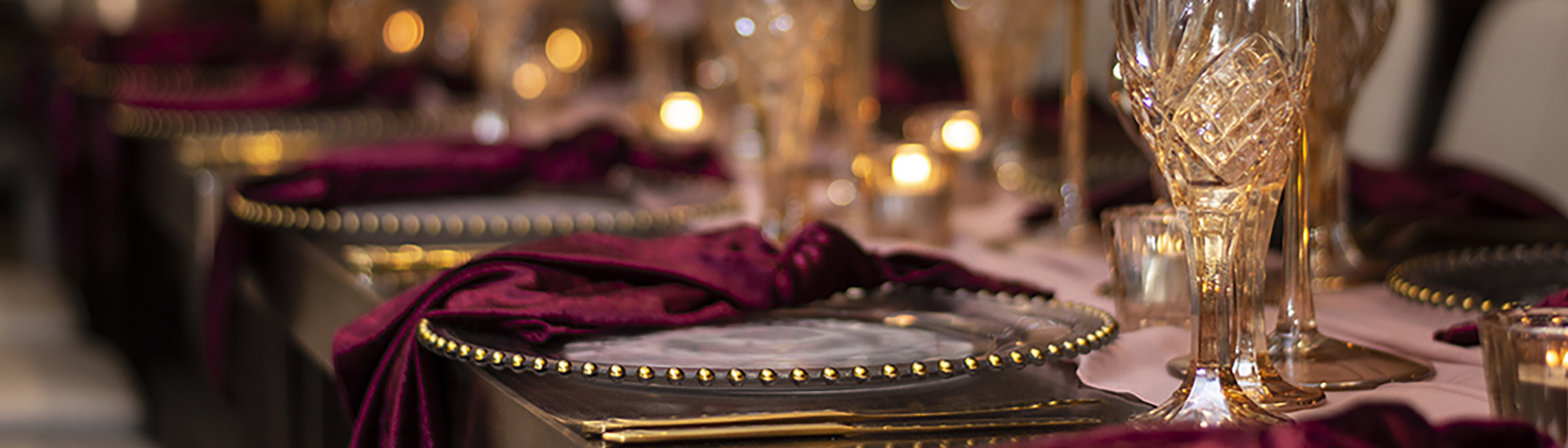 blackbird-wedding-reception-styling-amber-crystal-stemware-gold-beaded-glass-charger-plates-burgundy-velvet-napkins-banner