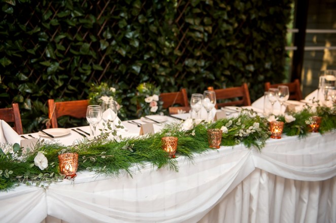 walkabout-creek-wedding-reception-styling-ferntree-bridal-table-fresh-greenery-runner-backdrop-rustic-timber-chairs