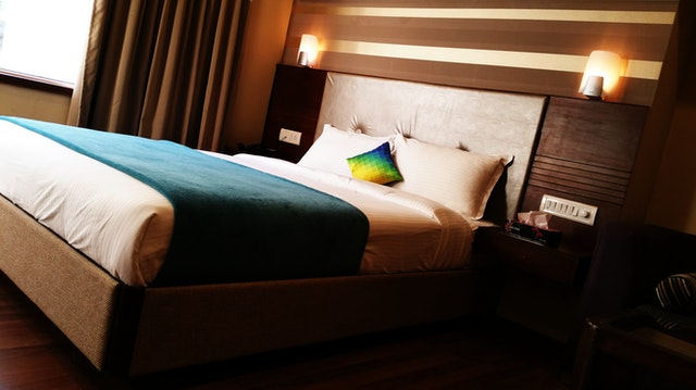 Hotel bed with throw and cushions