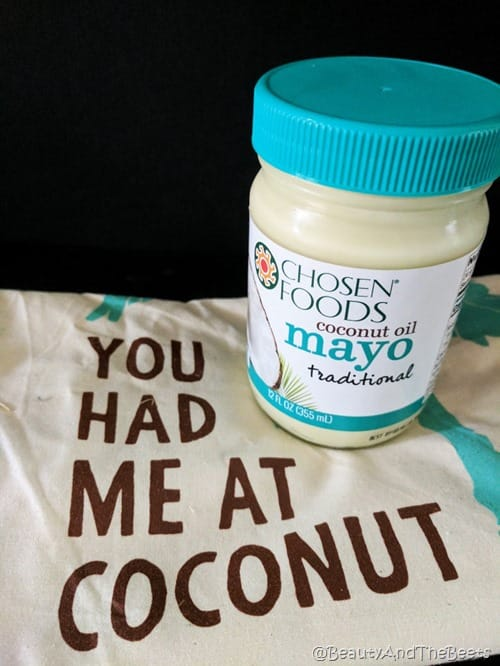 a jar of Chosen Foods Coconut Oil mayo on a towel reading you had me at coconut on a black background
