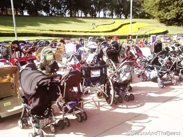 a mish mash of baby strollers on a sidewalk
