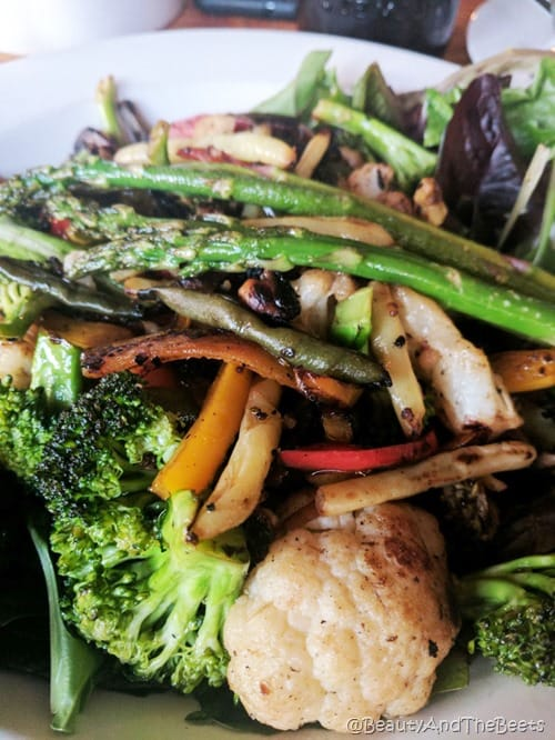 Roasted mix of cauliflower, broccoli, asparagus, mushrooms and peppers on a white plate