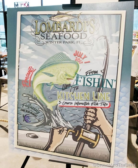 a poster featuring the fish tale event on an easel
