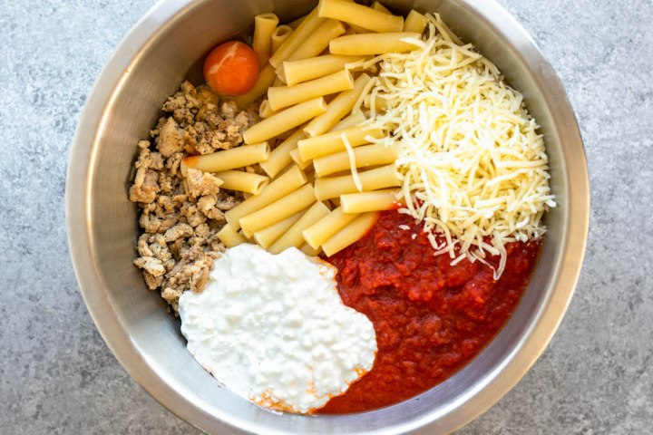 gluten free ziti noodles, cottage cheese, marinara, egg and mozzarella separated in a bowl
