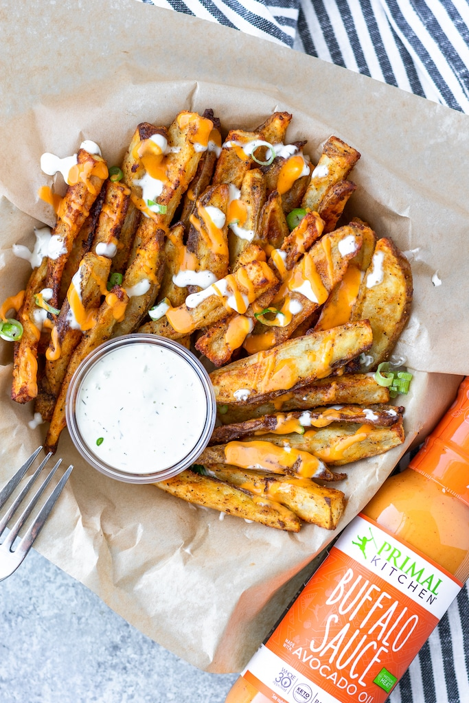 primal kitchen buffalo sauce with potato wedges