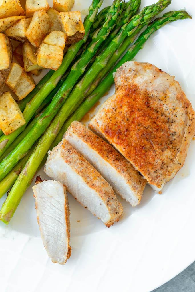 cut pork chops on a plate