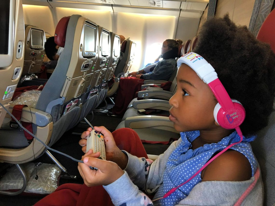 Kid-friendly headphones are a must when traveling with kids. They can watch their favorites shows on the plane's entertainment system or on their tablets.