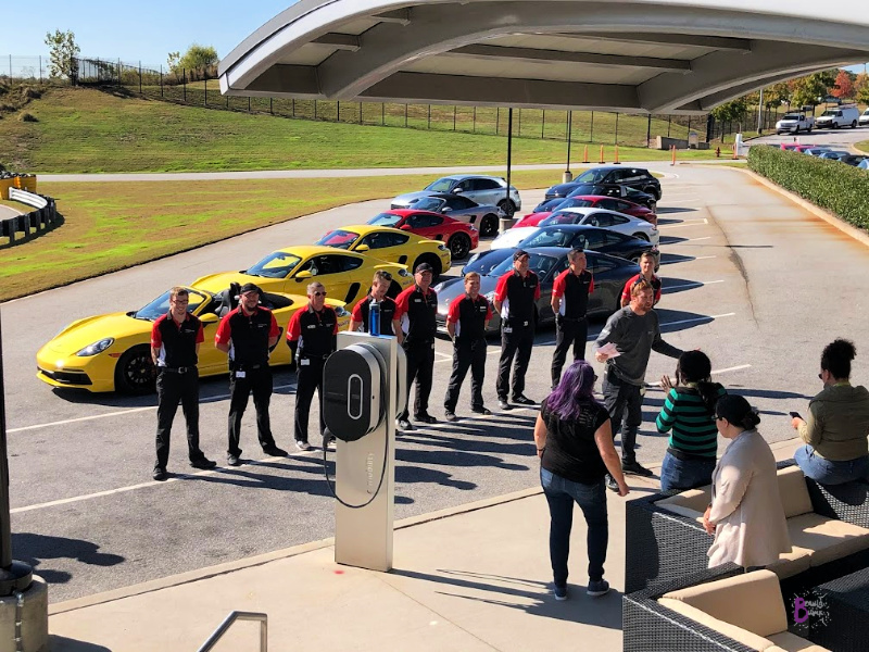 For each driving experience at the Porsche Experience Center Atlanta, drivers are assigned a driving coach.