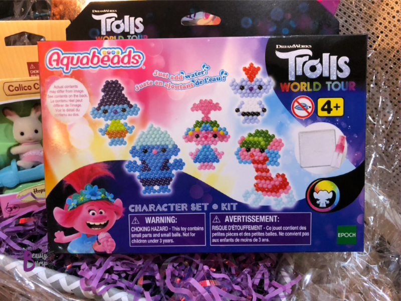 Activity kits like the Aquabeads Trolls World Tour Character Set allow kids to use a template to create their favorite Trolls World Tour characters with fun colorful beads.