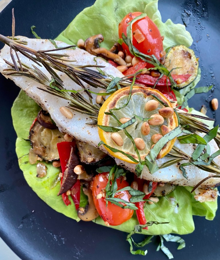 OH MY GOSH - THE BEST healthy spring recipe! Herbed Sea Bass with Wild Mushroom and Pine Nuts! This gluten free, keto and paleo dinner will be a family favorite! Also great for date night! #food #paleo #keto #glutenfree #grainfree #specificcarbohydratediet #yum #healthyfood #edrecovery