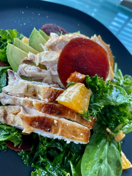 An OUTRAGEOUSLY delicious recipe that's a copycat from a high-end, popular NYC brunch spot! This Citrus Chicken Kale Salad is kissed with juicy orange, buttery avocado, crunchy almonds and hearty beets! And is Keto, Paleo and Gluten Free! #healthy #food