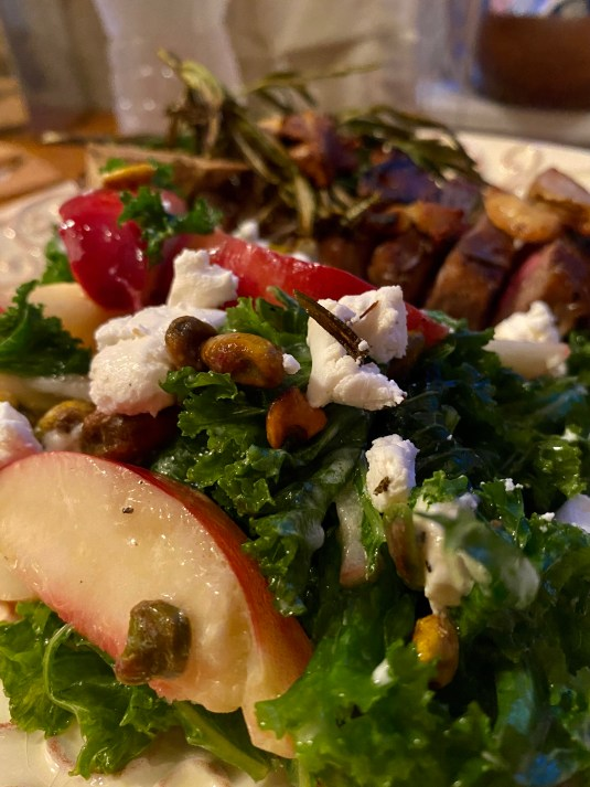 A #summer salad that is a CROWD PLEASER! Sweet, juicy peaches join forces with tangy goat cheese and crunchy pistachios in this #healthy #kale salad! Serve with a fabulous steak, and you've got a #Paleo meal for the ages! #food #recipe #glutenfree #vegetarian #lowcarb #edrecovery
