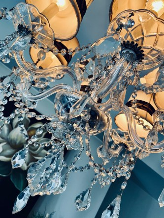 After cleaning ten years of grime off my crystal chandelier, I realized that that's what God had done with me in my recovery from anorexia. A powerful take on a mundane task. #recovery #catholic #anorexia #eatingdisorder #edrecovery #healing #mentalhealth #faith #god #christianity