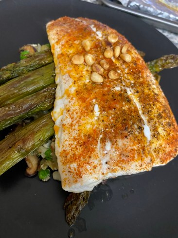 Grits just went KETO! Whaaat?! That's right! Succulent halibut filets get the cajun treatment, with cauliflower grits! It's a delicious gluten free dinner that'll have you singing for your supper! #keto #glutenfree #lowcarb #paleo #food #dinner #recipe #healthyfood #specificcarbohydratediet #cooking