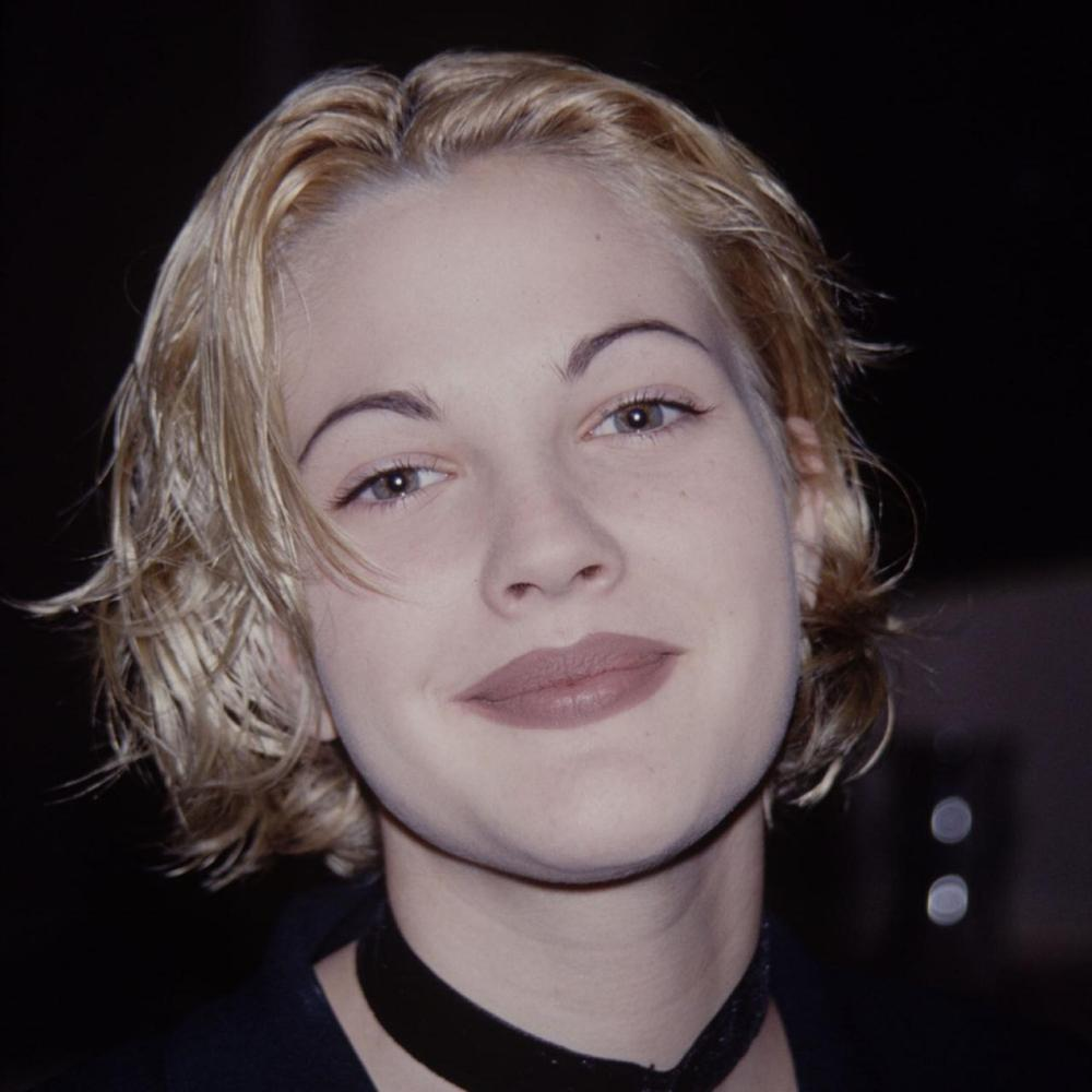 drew barrymore circa 1990 with thin arched brows
