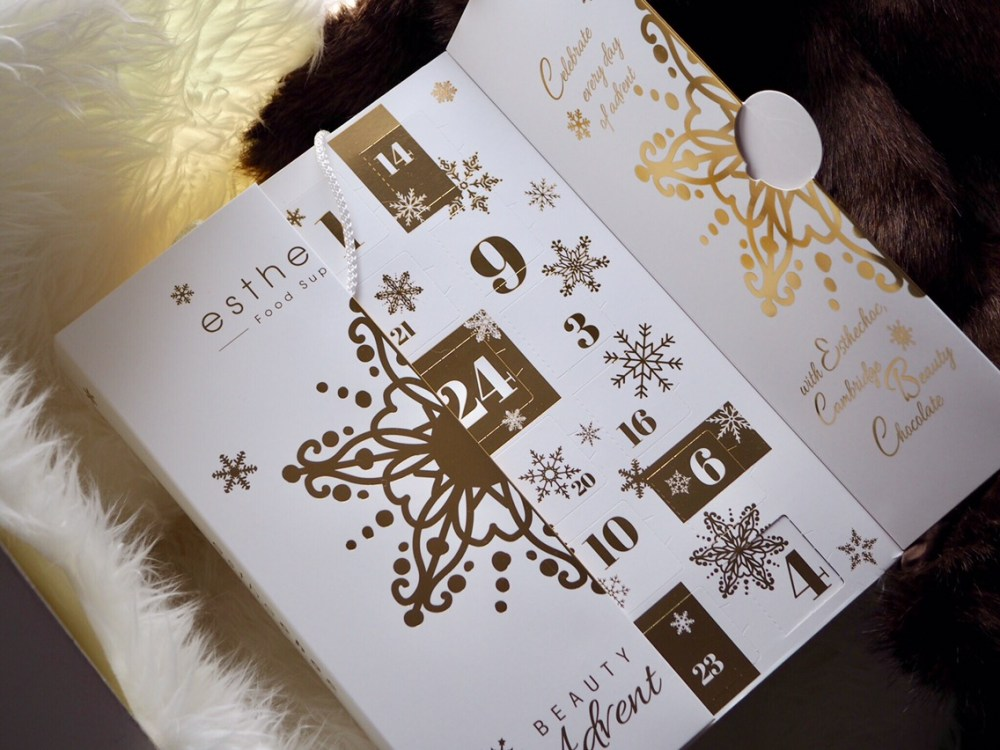 """Esthechoc Limited Edition """"Smart Chocolate""""Advent Calendar white advent calendar with gold lettering"""