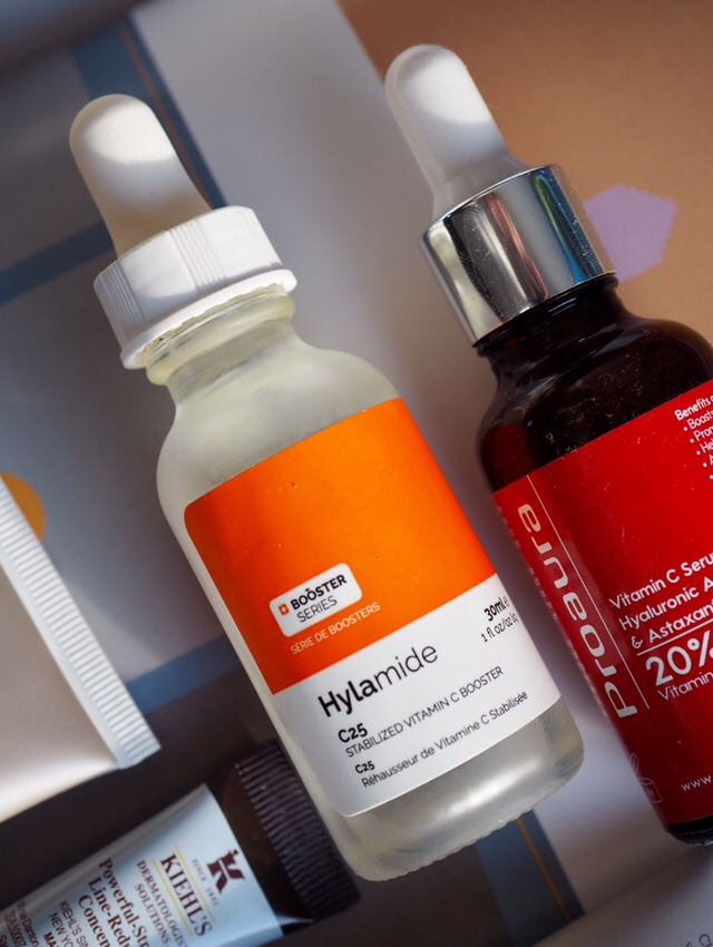 Close up of dropper bottles Hylamide with an orange label and Proaura with red label