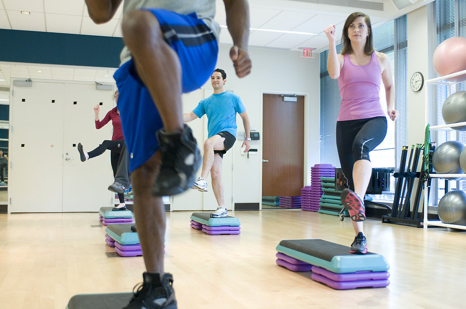 17357-men-and-women-performing-aerobic-exercises-pv