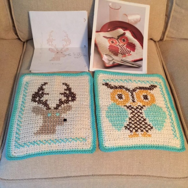 crochet project with cross stitching on it