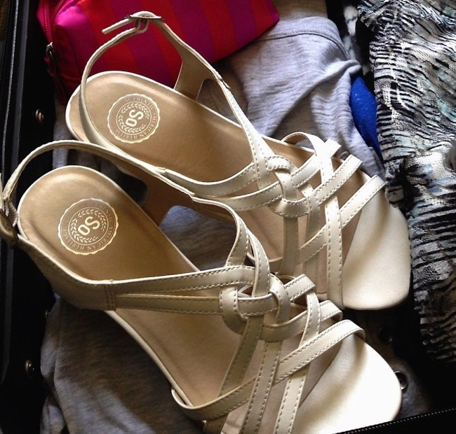 white sandals-in suitcase